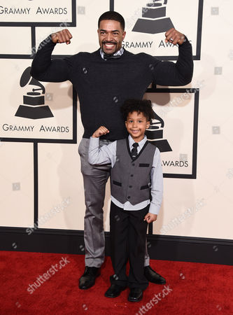 David Otunga, left, and David Otunga Jr. arrive at the 57th annual Grammy Awards at the Staples Center, in Los Angeles