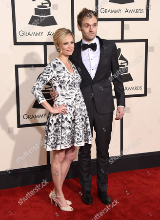 Claire Coffee, left, and Chris Thile arrive at the 57th annual Grammy Awards at the Staples Center, in Los Angeles
