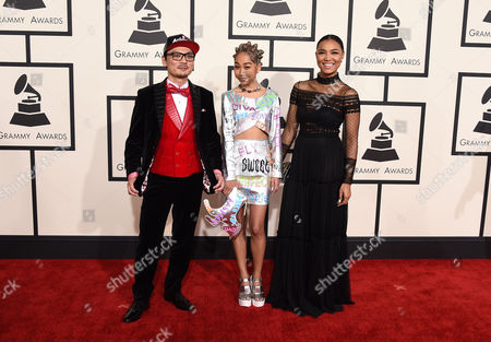 Spicy Chocolate, from left, Aoyama Thelma, and Crystal Kay arrive at the 57th annual Grammy Awards at the Staples Center, in Los Angeles