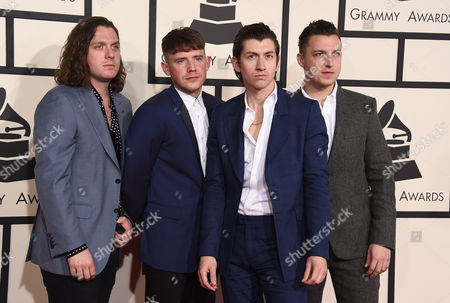 Nick O'Malley, from left, Jamie Cook, Alex Turner, and Matt Helders of Arctic Monkeys arrive at the 57th annual Grammy Awards at the Staples Center, in Los Angeles