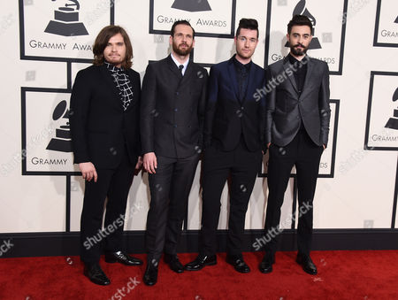 """Chris """"Woody"""" Wood, from left, Will Farquarson, Dan Smith, and Kyle J Simmons of Bastille arrive at the 57th annual Grammy Awards at the Staples Center, in Los Angeles"""