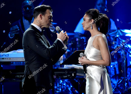 Cheyenne Jackson, left, and Alexandra Silber perform at the 57th annual Grammy Awards, in Los Angeles