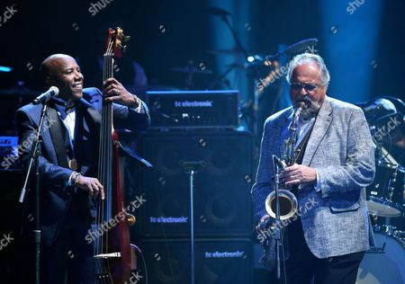 Nathan East, left, and Joe Lovano perform at the 57th annual Grammy Awards, in Los Angeles