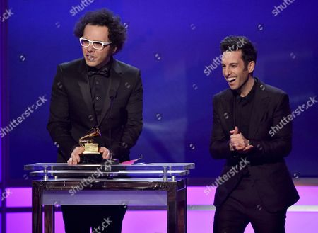 Ian Axel, left, and Chad Vaccarino, of A Great Big World, accept the award for best pop duo/group performance for Say Something at the 57th annual Grammy Awards, in Los Angeles