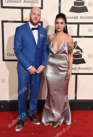 Stock Image of Colin Tilley, left, and guest arrive at the 58th annual Grammy Awards at the Staples Center, in Los Angeles