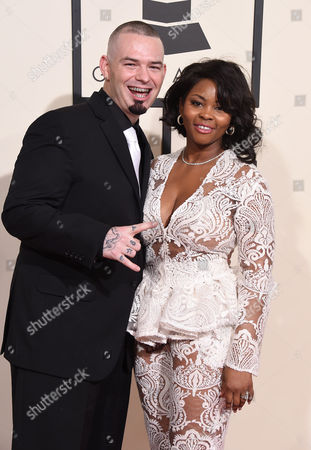 Paul Wall, left, and Crystal Wall arrive at the 58th annual Grammy Awards at the Staples Center, in Los Angeles