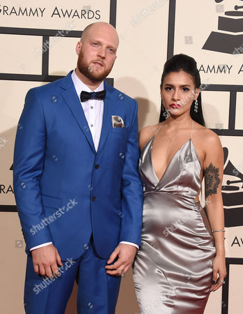 Colin Tilley, left, and guest arrive at the 58th annual Grammy Awards at the Staples Center, in Los Angeles