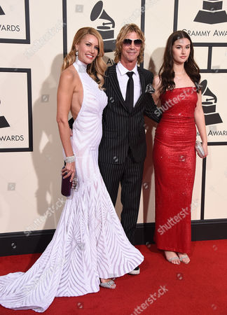 Susan McKaga, from left, Duff McKagan, and Mae McKagan arrive at the 58th annual Grammy Awards at the Staples Center, in Los Angeles