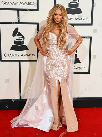 Kaya Jones arrives at the 58th annual Grammy Awards at the Staples Center, in Los Angeles