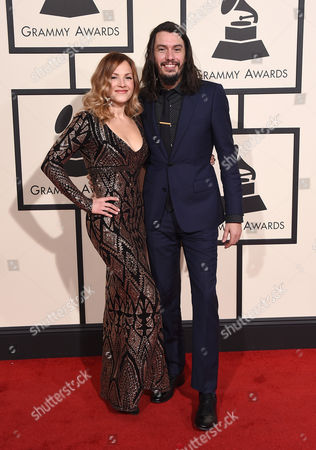 Adriel Denae, left, and Cory Chisel arrive at the 58th annual Grammy Awards at the Staples Center, in Los Angeles