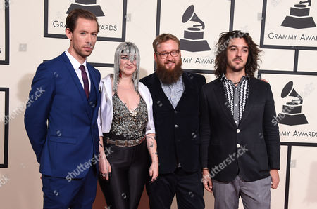 Simon Mavin, from left, Nai Palm, Paul Bender, and Perrin Moss of Hiatus Kaiyote arrives at the 58th annual Grammy Awards at the Staples Center, in Los Angeles