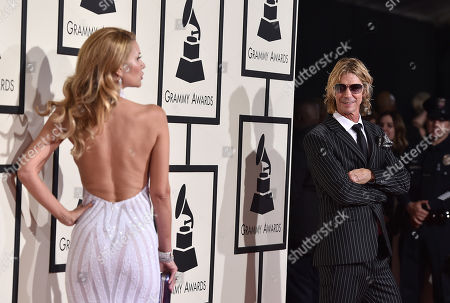 Susan McKaga, left, and Duff McKagan arrive at the 58th annual Grammy Awards at the Staples Center, in Los Angeles
