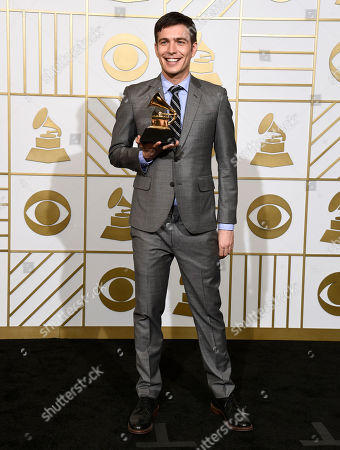 "Stock Image of Tim Kubart poses in the press room with the award for best children's album for ""Home"" at the 58th annual Grammy Awards at the Staples Center, in Los Angeles"