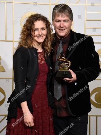 """Abigail Washburn, left, and Bela Fleck winners of the award for best folk album for """"Bela Fleck & Abigail Washburn"""" pose in the press room at the 58th annual Grammy Awards at the Staples Center, in Los Angeles"""