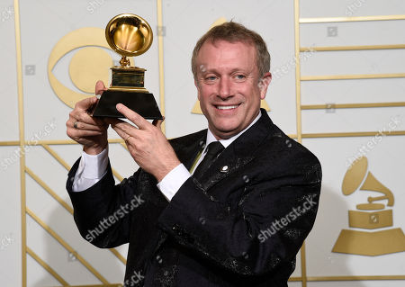 Stock Photo of Charles Bruffy poses in the press room with the award for best choral performance for Rachmaninoff: All-Night Vigil at the 58th annual Grammy Awards at the Staples Center, in Los Angeles