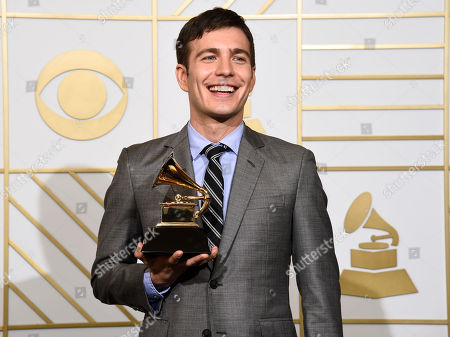 "Tim Kubart poses in the press room with the award for best children's album for ""Home"" at the 58th annual Grammy Awards at the Staples Center, in Los Angeles"