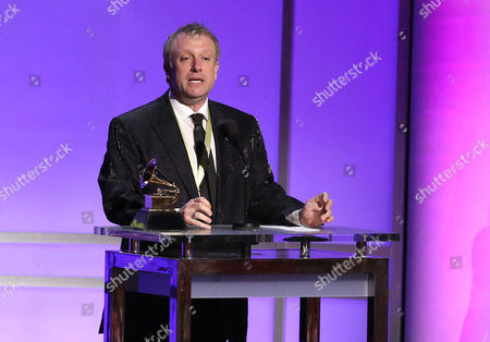 """Charles Bruffy accepts the award for best choral performance for """"Rachmaninoff: All-Night Vigil"""" at the 58th annual Grammy Awards, in Los Angeles"""