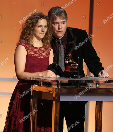 """Abigail Washburn, left, and Bela Fleck accept the award for folk album for """"Bela Fleck & Abigail Washburn"""" at the 58th annual Grammy Awards, in Los Angeles"""