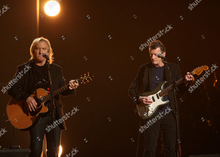 Stock Picture of Joe Walsh, left, and Steuart Smith perform a tribute to Glenn Frey at the 58th annual Grammy Awards, in Los Angeles