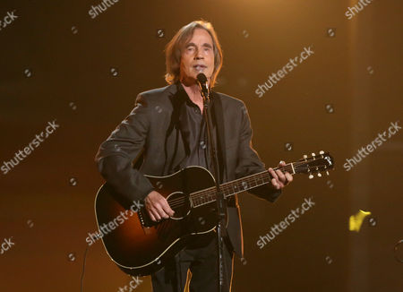"""Jackson Browne performs """"Take It Easy"""" during a tribute to Glenn Frey at the 58th annual Grammy Awards, in Los Angeles"""