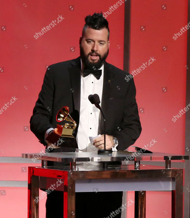 Dave Aude accepts the award for remixed recording, non-classical at the 58th annual Grammy Awards, in Los Angeles