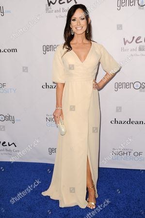 Stock Image of Patty Malcolm arrives at The 6th Annual Night Of Generosity Benefit, in Beverly Hills, Calif