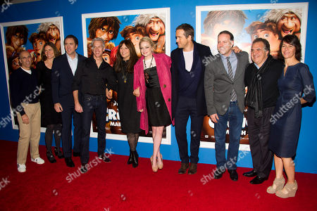 "Jeffrey Katzenberg, from left, Jane Hartwell, Nicolas Cage, Chris Sanders, Catherine Keener, Emma Stone, Ryan Reynolds, Kirk DeMicco, Jim Gianopulos and Kristine Belson attend ""The Croods"" premiere on in New York"