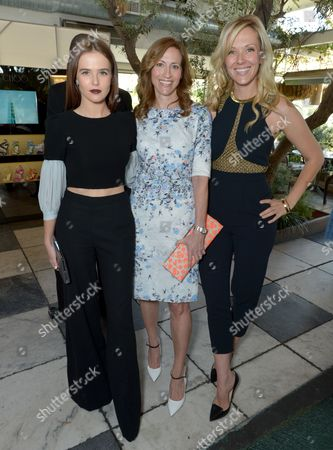 Zoey Deutch, Dana Gers, VP of global marketing at Jimmy Choo, and stylist Tara Swennen attend The Hollywood Reporter & Jimmy Choo Celebration of the Most Powerful Stylists in Hollywood,, in West Hollywood, Calif
