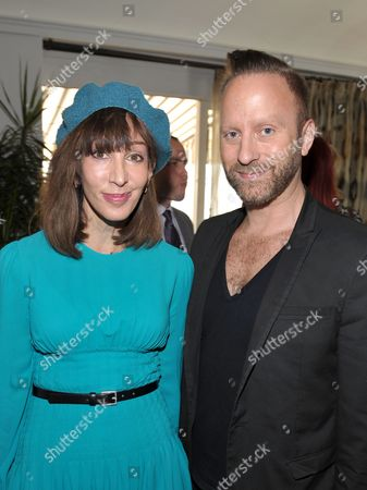 From left, Merle Ginsberg and Gregory Arlt are seen at the The Hollywood Reporter's Beauty Luncheon held at the Chateau Marmont on in Los Angeles