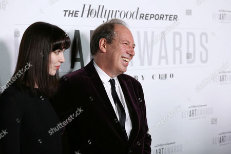 """Composer Hans Zimmer, right, and Zoe Zimmer arrive at """"The Hollywood Reporter's Key Art Awards"""" Powered by Clio, in Los Angeles"""