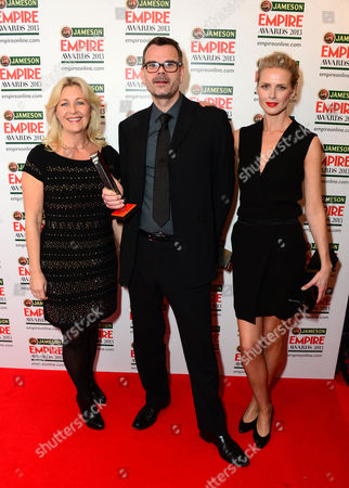 Stock Picture of Marianne Gray, Asle Vatn and Synnove Macody Lund, winner of Best Thriller Award for Headhunters seen at the Jameson Empire Film Awards 2013, Grosvenor House in London on