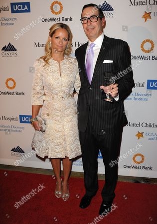 """Stock Picture of Heather Mnuchin, left, and Steven Mnuchin arrive at The Kaleidoscope Ball's """"Designing The Future"""" at the Beverly Hills Hotel on in Beverly Hills, Calif"""