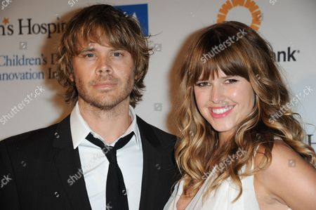 "Eric Christian Olsen, left, and Sarah Wright arrive at The Kaleidoscope Ball's ""Designing The Future"" at the Beverly Hills Hotel on in Beverly Hills, Calif"