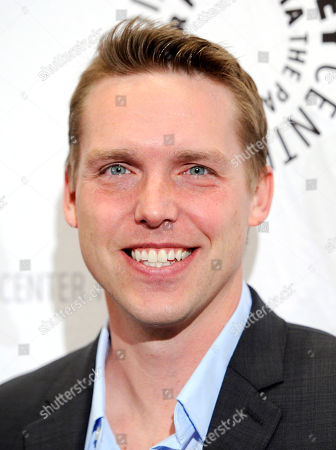 "Kevin Biegel, creator and executive producer of the television series ""Enlisted,"" poses at the premiere screening of the show, at The Paley Center for Media in Beverly Hills, Calif"