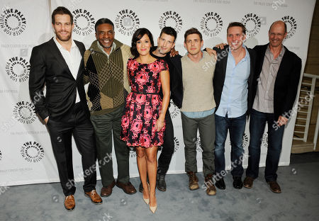 "Left to right, ""Enlisted"" cast members Geoff Stults, Keith David, Angelique Cabral, Parker Young and Chris Lowell pose with the show's creator/executive producer Kevin Biegel and executive producer Mike Royce at the premiere screening of the show, at The Paley Center for Media in Beverly Hills, Calif"