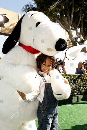 Cree Taylor Hardrict and Snoopy seen at Twentieth Century Fox Premiere of 'The Peanuts Movie' at Regency Village Theater, in Los Angeles, CA