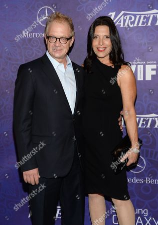 Jeff Perry and wife Linda Lowy arrive at Variety and Women in Film's pre-Emmy celebration at Gracias Madre on in West Hollywood, Calif