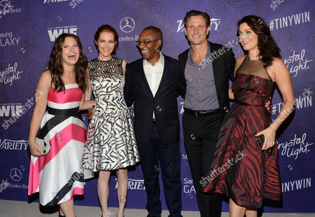 From left, Katie Lowes, Darby Stanchfield, Columbus Short, Tony Goldwyn and Bellamy Young arrive at Variety and Women in Film's pre-Emmy celebration at Gracias Madre on in West Hollywood, Calif