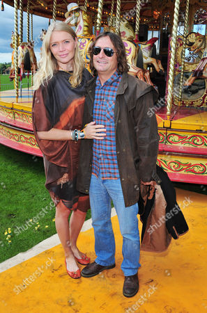 Jodie Kidd, Andrea Vianini poses at the Veuve Clicquot Gold Cup Polo at Cowdrey Park on in Midhurst