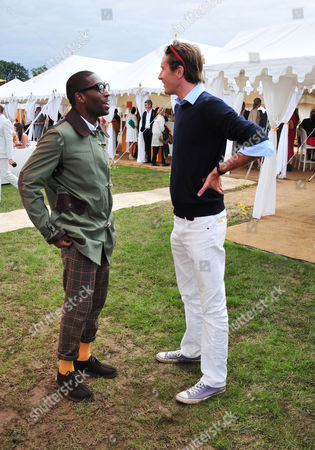 Stock Picture of Tiny Tempah, Otis Ferry poses at the Veuve Clicquot Gold Cup Polo at Cowdrey Park on in Midhurst