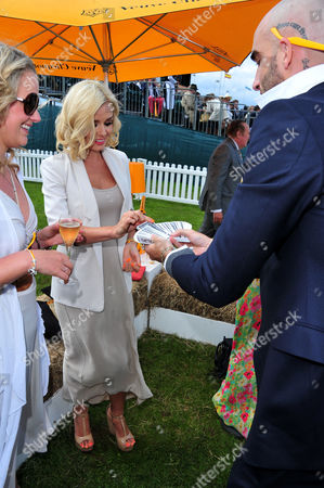Katherine Jenkins, Christopher Murray Coutts poses at the Veuve Clicquot Gold Cup Polo at Cowdrey Park on in Midhurst