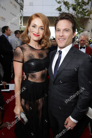 Erica Piccininni and Mike Doyle seen at the Warner Bros. Premiere of 'Jersey Boys' at the 2014 Los Angeles Film Festival held at Regal Cinemas LA Live Stadium 14, in Los Angeles