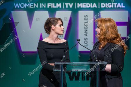Actress Kristen Stewart, left, and writer Stephenie Meyer speak at the Women in Film 2015 Crystal + Lucy Awards at the Hyatt Regency Century Plaza on in Los Angeles