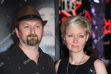 """Neil Marshall, left, and Axelle Carolyn arrive at the world premiere of """"Insidious: Chapter 2"""" at Universal CityWalk on in Universal City, Calif"""