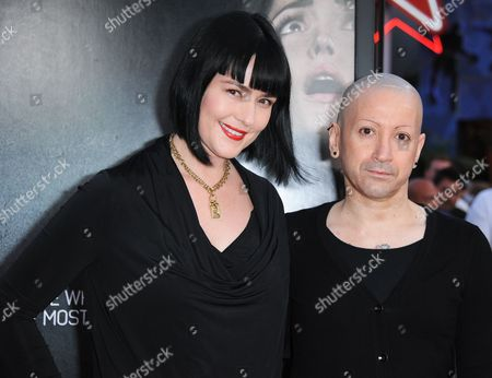 """Joseph Bishara, right, arrives at the world premiere of """"Insidious: Chapter 2"""" at Universal CityWalk on in Universal City, Calif"""