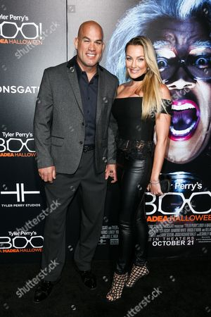 """Tito Ortiz, left, and Amber Nicole Miller attend the world premiere of """"BOO! A Madea Halloween"""" held at ArcLight Cinerama Dome, in Los Angeles"""