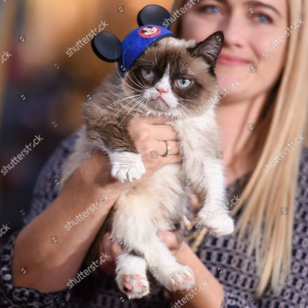 """Grumpy Cat and Tabatha Bundesen arrive at the World Premiere Of """"Cinderella"""", in Los Angeles"""