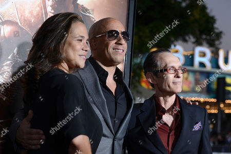 """From left to right, executive producer Samantha Vincent, actor Vin Diesel and director David Twohy arrive on the red carpet at the world premiere of the feature film """"Riddick"""" at the Regency Village Theatre on in Los Angeles"""