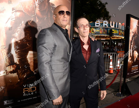 """From left to right, actor Vin Diesel and director David Twohy arrive on the red carpet at the world premiere of the feature film """"Riddick"""" at the Regency Village Theatre on in Los Angeles"""
