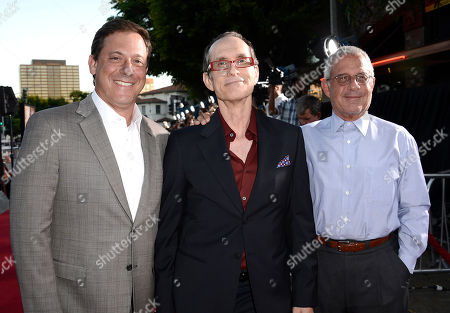 """From left to right, executive Adam Fogelson, director David Twohy and executive Ron Meyer arrive on the red carpet at the world premiere of the feature film """"Riddick"""" at the Regency Village Theatre on in Los Angeles"""
